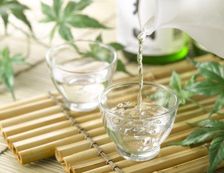 sake: Sake on bamboo tray with bottle Stock Photo
