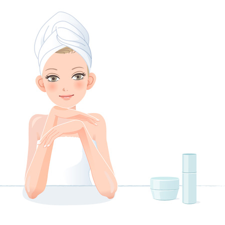 Pretty woman in towel smiling with skincare cosmetics after bath.