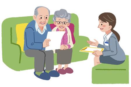 Glimlachend bejaarde echtpaar overlegt met Geriatric zorgmanager