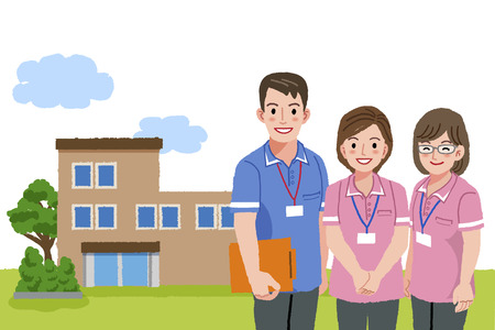 Three caregivers standing with nursing house background.