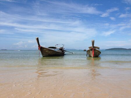 railay: Boats at Railay beach Thailand Stock Photo