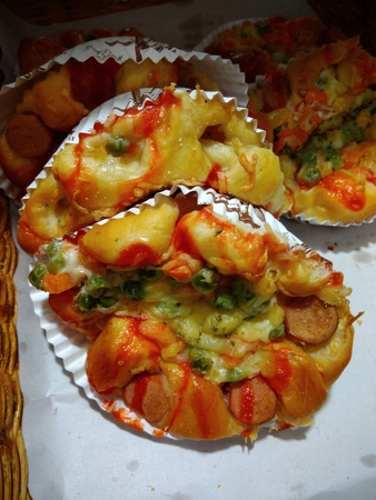 Delicious mini pizza in a pastry cup