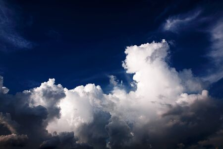 Blue sky with abstractive clouds - fluffy clouds photo