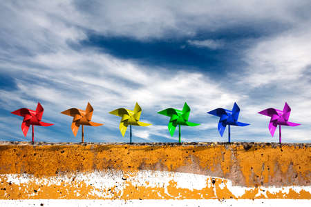 Pinwheels and dramatic blue sky, express the unrestrictedness and think outside the box photo
