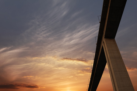 cut through: Highway cut through across the sky with beautiful flaming sunset glow Stock Photo
