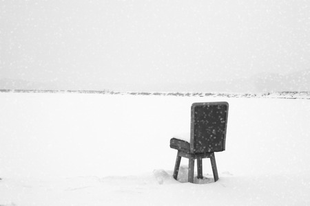 endlessly: In snowy day, a chair waiting for someone