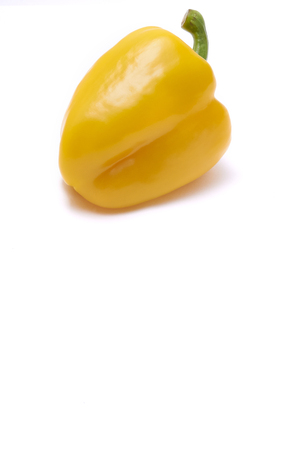 paprica: Yellow paprica on white background with copy space