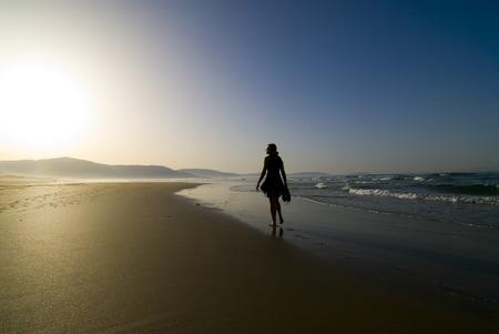 peacefull: Woman walking by the seaside