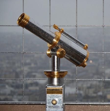 Telescope at Eiffel tower in Paris photo
