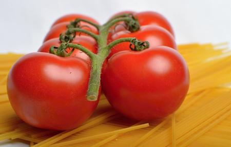 Tomatoes and spaghetti photo