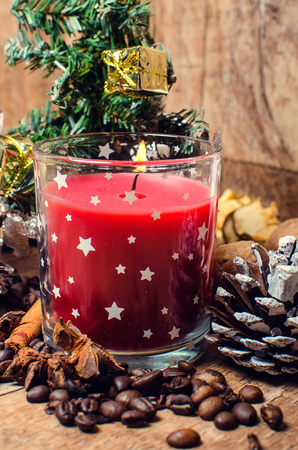 Christmas red candle, spices, coffee, cinnamon and nuts will add a Christmas atmosphere.