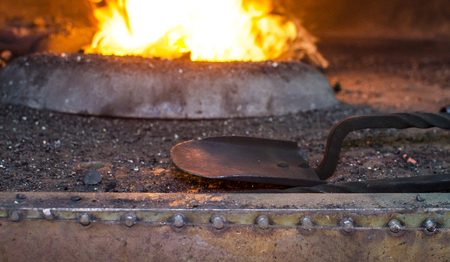 Blacksmith at work, hit with a hammer by a hot metal on the anvil. Stock Photo