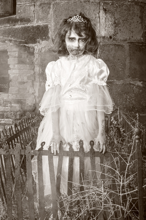 Spooky zombie baby in a cemetery. Imagens