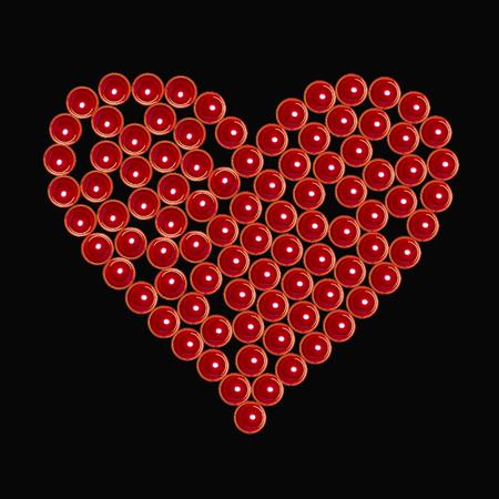 Red valentine burning candlesas heart at black Imagens