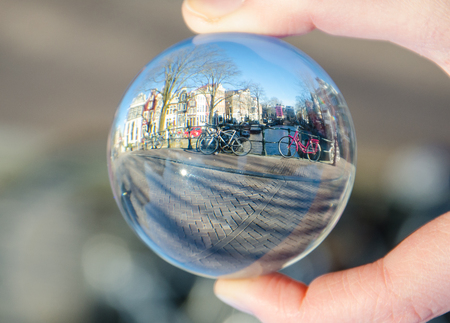 view of the bicycle in Amsterdam over a glass ball Stockfoto