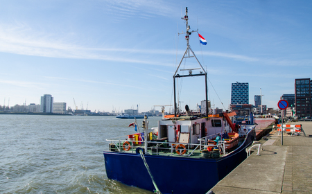 A boat moored in the port of Rotterdam. Фото со стока