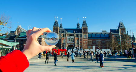 Amsterdam in glass ball on the hand.