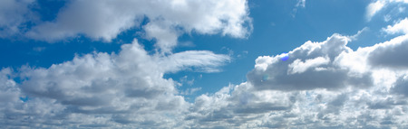 Blue spring sky full of white clouds. Stock Photo