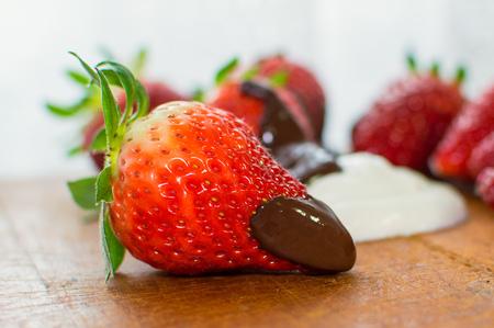 Strawberry with chocolate as fresh bio dessert.
