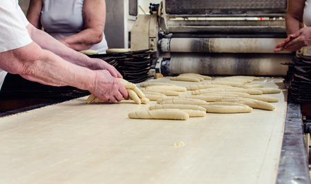 Working on a sweet pastry in a big industrial bakery.