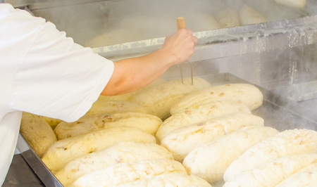 Industrial cooking of popular classical dumplings. Stock Photo