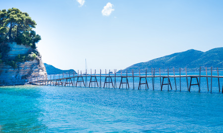 Wooden bridge on the small island of Cameo in Greece Stock Photo