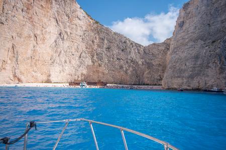 Ship sailing into the bay Navagio at island Zakynthos. Stock fotó