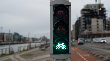 Green color at the traffic lights for cyclists.