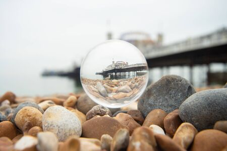Brighton pier and seagull in the glass ball. Фото со стока