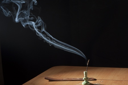 incense sticks: Incense Sticks on a table on a black background