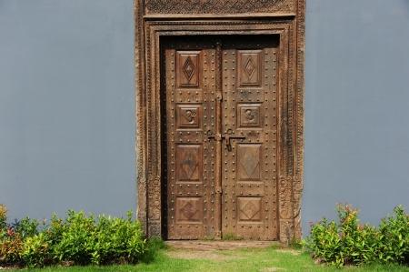 Vintage wood doors and grey wall photo
