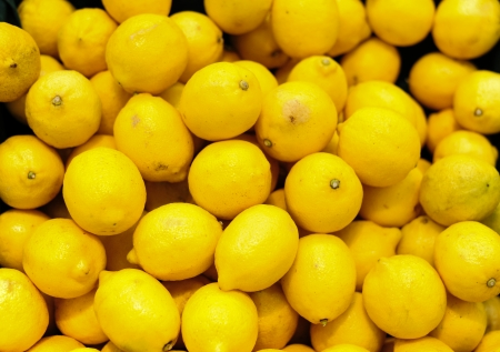 Colorful Lemons In Market Stock Photo