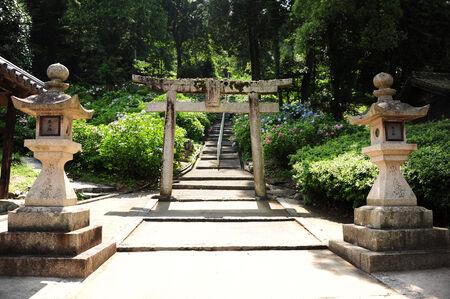 Old wooden Torii in Japanese shrine Stock Photo