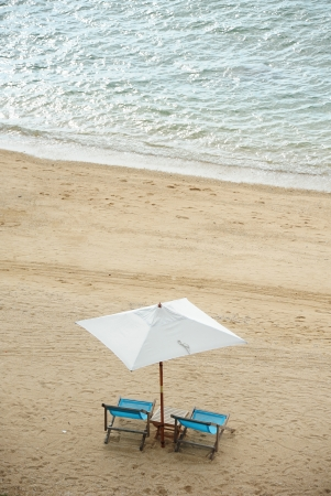 Beach chairs on the sand photo