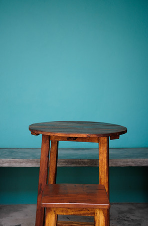 nice accommodations: Background with wooden table and grunge blue wall Stock Photo