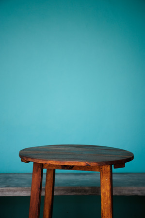 Background with wooden table and grunge blue wall Stock Photo