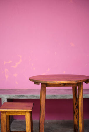 nice accommodations: Background with wooden table and grunge pink wall