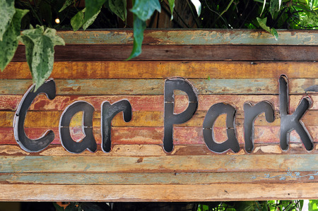 carpark sign on wood, natural background photo