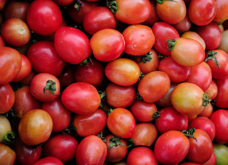 background of fresh vine tomatoes for sale at a market photo