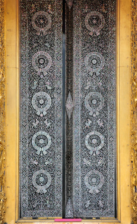 Ancient golden carving wooden window of Thai temple photo