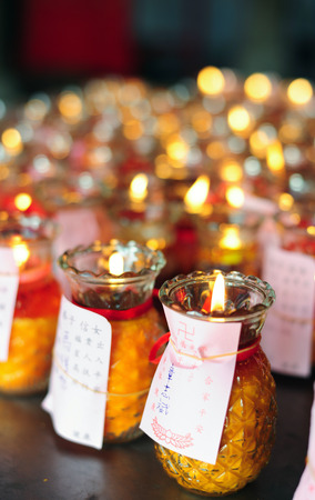 candles in the glass in the chinese temple photo