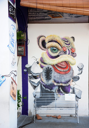 gained: PENANG, MALAYSIA- MAY 12, 2014   Wall grafitti of lion head, Penang Malaysia  These wall graffitti has gained reputation and become part of Penang tourist attractions
