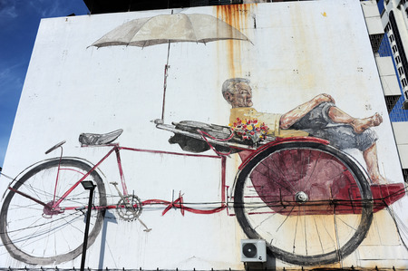 conjunction: GEORGE TOWN, PENANG, MALAYSIA - MAY 12 2014   Street Mural tittle  The Awaiting Trishaw Peddler  painted by Ernest Zacharevic in Penang Road, in conjunction with the 2012 George Town Festival  Editorial