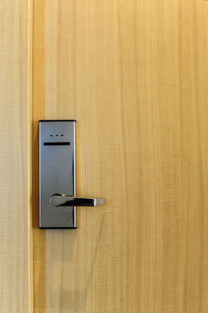 Hotel electronic lock on wooden door photo