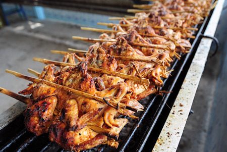 Roasting chicken traditional Thai food  Wichian Buri Grilled Chicken  photo