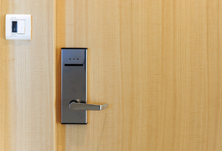 Hotel electronic lock on wooden door  Reklamní fotografie