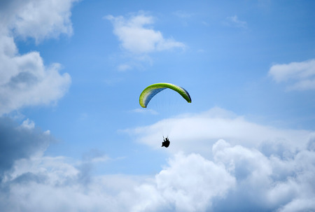 ail: Parasailing under blue sky  Stock Photo