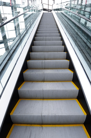 angled view: Wide angled view to perspective escalators stairway