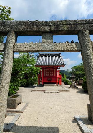Old wooden Torii in Japanese shrine