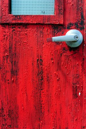door knob with Rusted red painted metal wall photo